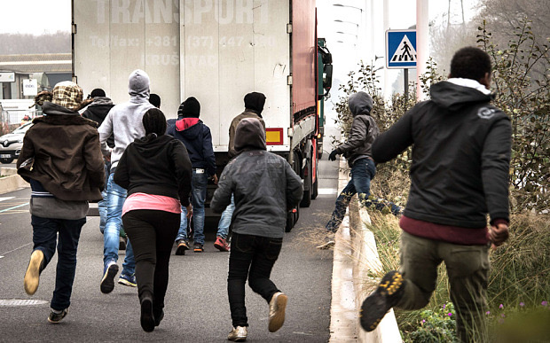 Library photo of immigrants at Calais